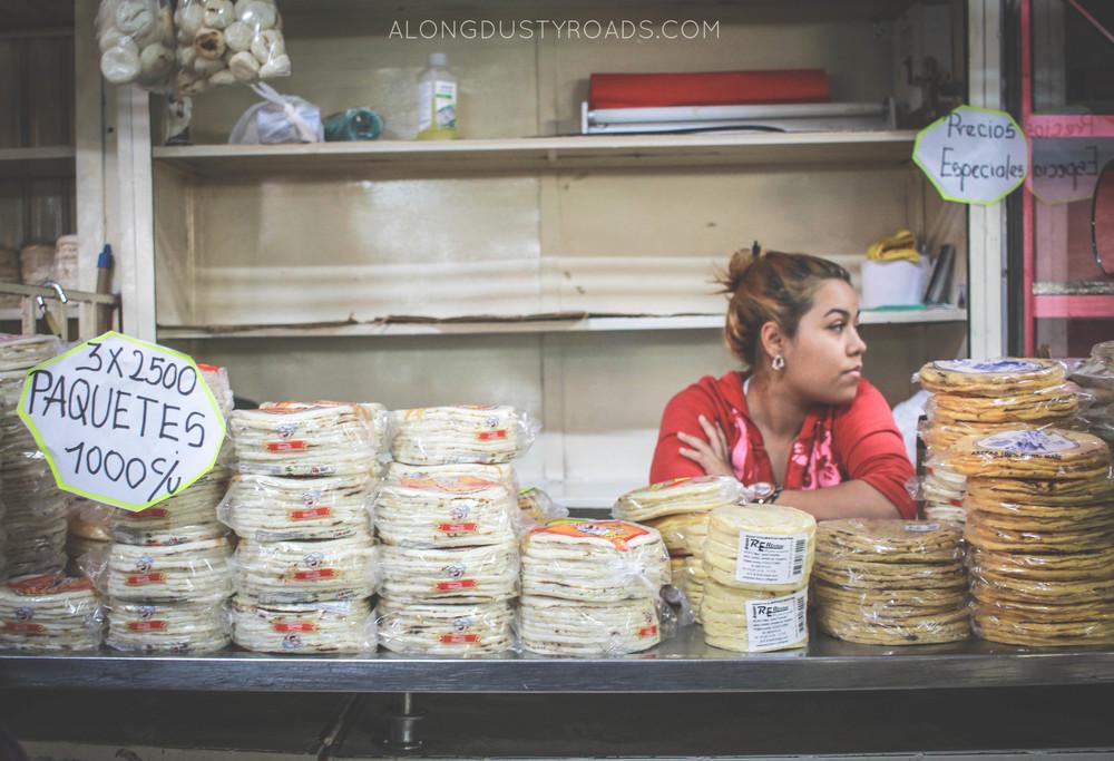 the arepa girl - minorista market, medellin