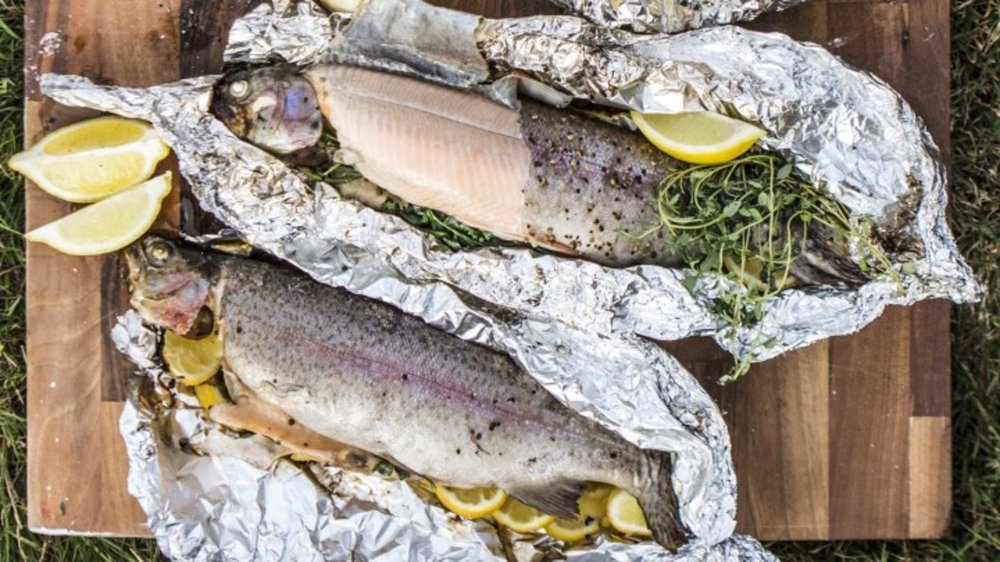 Trout cooked on an open fire