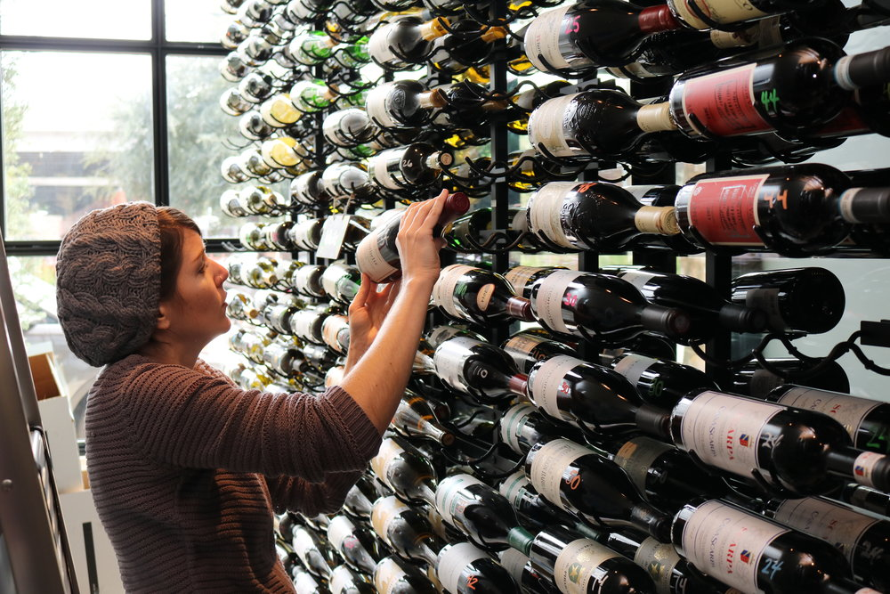Hospitality and Wine Consultant Kellen Walker checks the wine inventory.