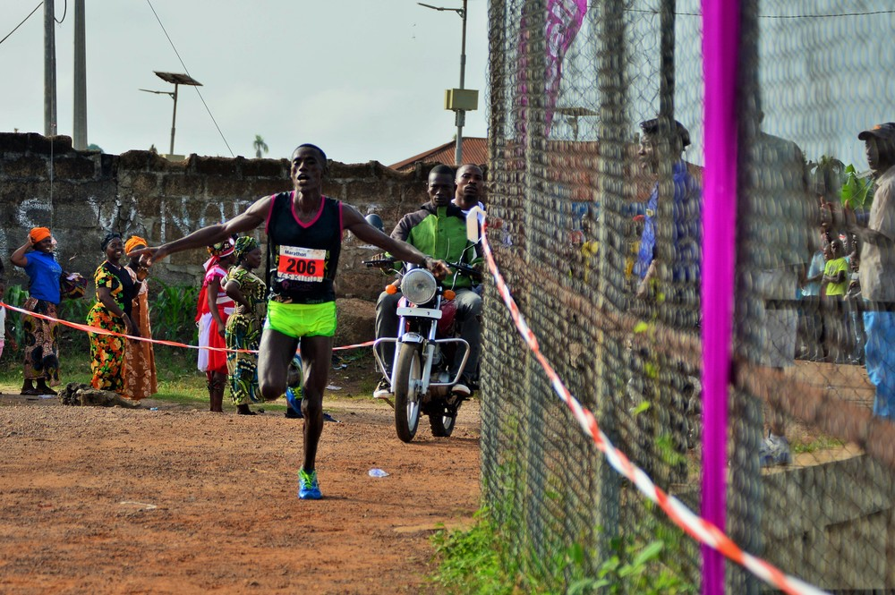 Mustafa 'Eskimo' Kamara as he crosses the finish line as the winner of the 2016 Sierra Leone Marathon