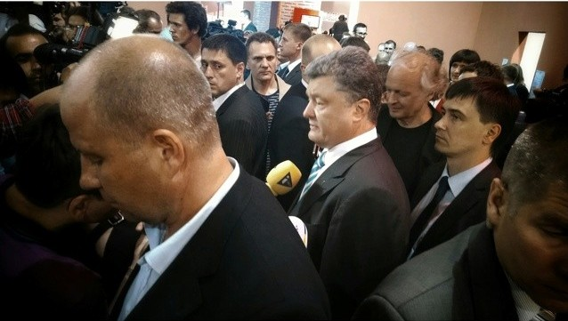 Kiev, Ukraine - Petro Poroshenko speaks with journalists at Art Arsenal as exit polls place him as the winner. copyright Jason Blevins 2014