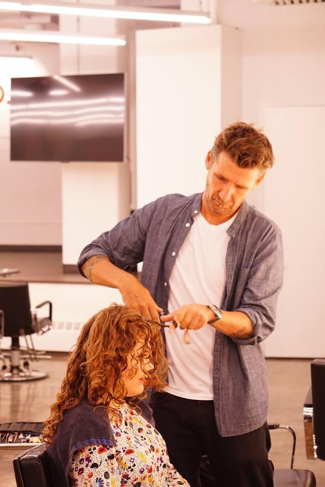 Paul Merritt making curls more shapely.