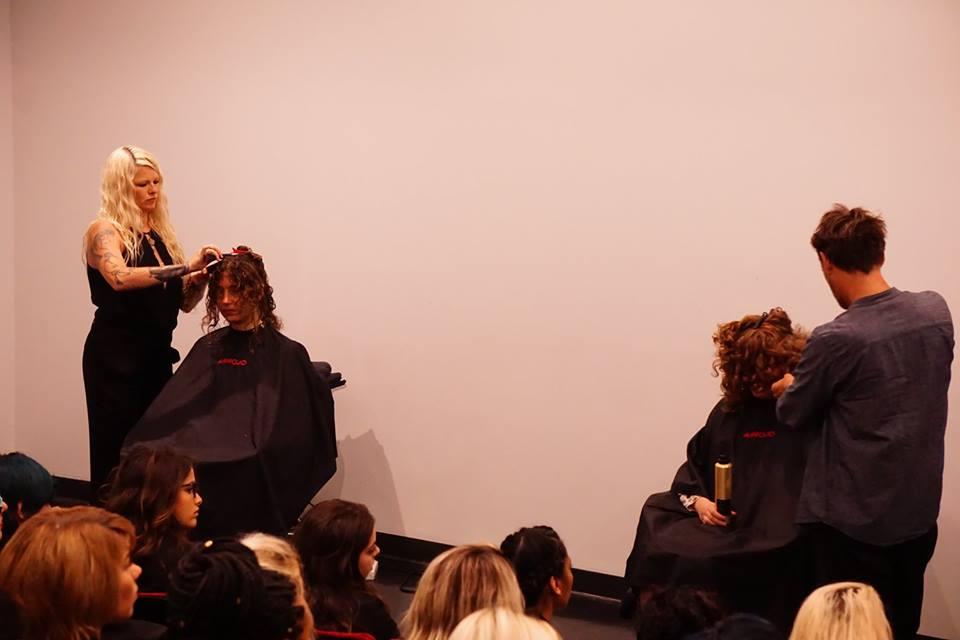 Amanda Jenkins (left) and Paul Merritt working on curly hair models.