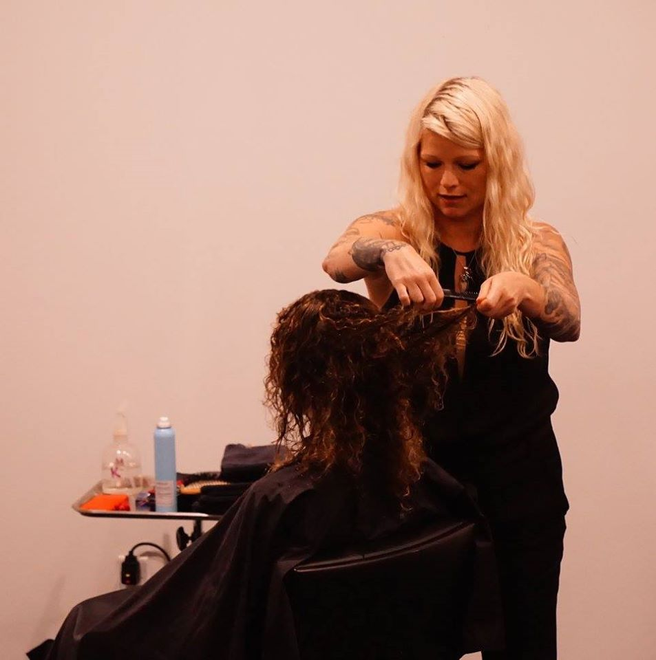 Amanda Jenkins gets her hands in the curls.