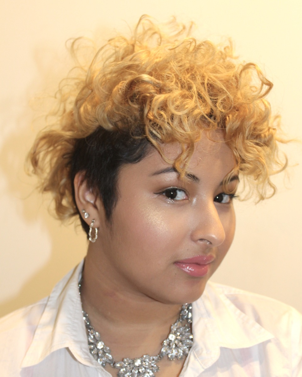 Two-tone undercut highlights perfectly imperfect curls.