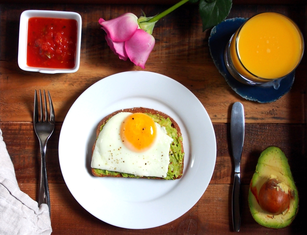 Avocado toast with sunny side up egg sprinkled with red pepper flakes and a side of salsa. Perfect winning brekkie. All photos by © Suzanne Spiegoski