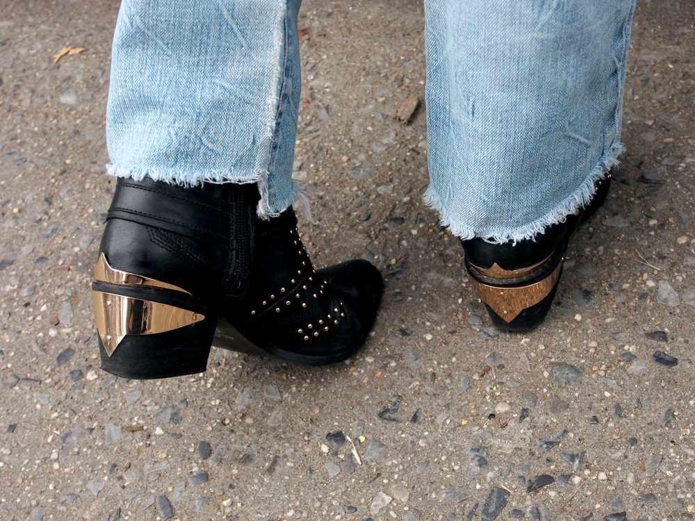 Gold plates, studs and black leather; my favorite  Aldo  ankle booties paired with ripped jeans from  American Eagle .