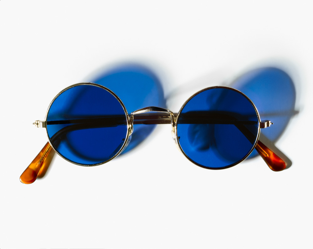 John Lennon's blue-tinted sunglasses. (Photograph by Henry Leutwyler)