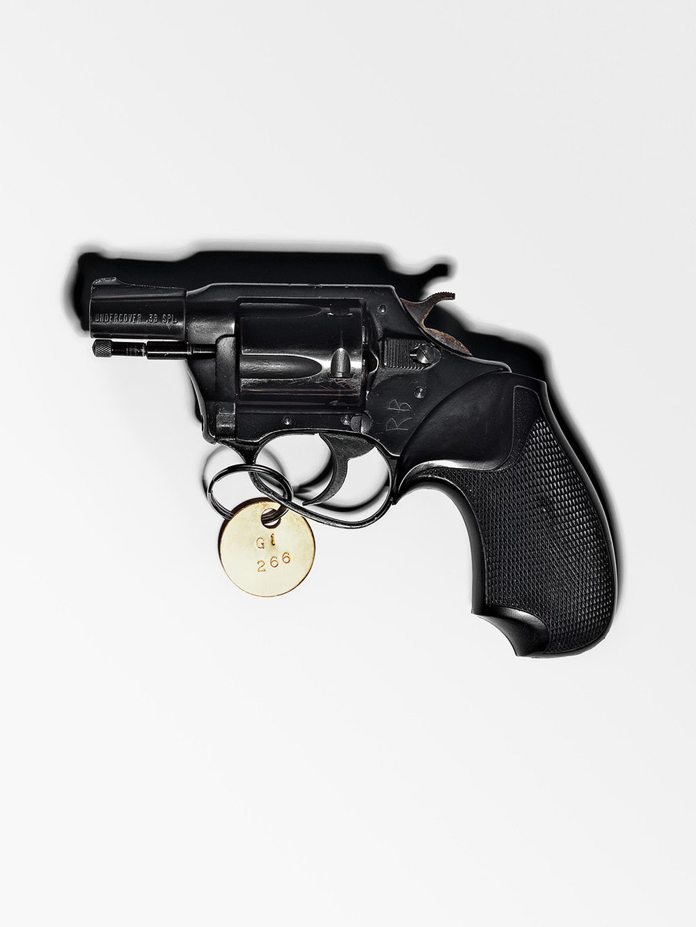 Document Book Cover: The .38 caliber revolver used to assassinate John Lennon. (Photograph by Henry Leutwyler)