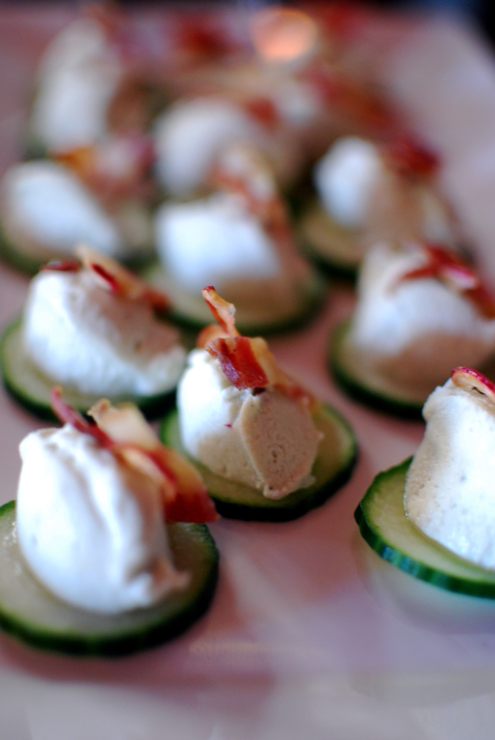 A smoky blue cheese and cucumber canapé with candied radish and bacon served during a beer dinner at South Kitchen and Bar on Tuesday, July 29, 2014 (André Gallant | @andregallant | andrejgallant@gmail.com).