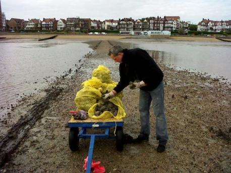 Seized - Carl Robinson, a Southend Council officer, with an illegal oyster haul. From Southend Standard