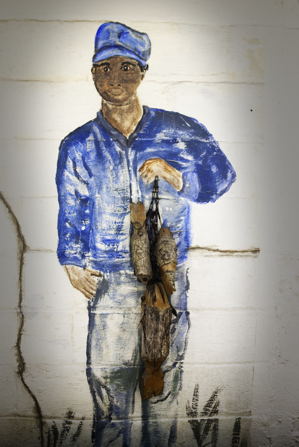 Painting of a Pin Point Fisherman on the cannery wall.