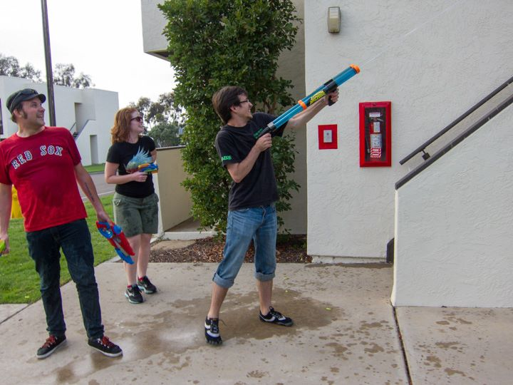 Me and Patrick (with Eliza Tiernan in the middle) battling to the death in a  water gun fight against Robert Crais & Kim Stanley Robinson