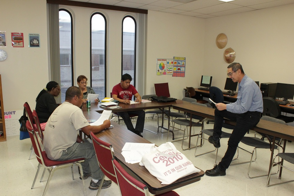 Janus Lazarus, a volunteer NALA tutor and Board Member, works with a group of students at Joplin NALA Read.