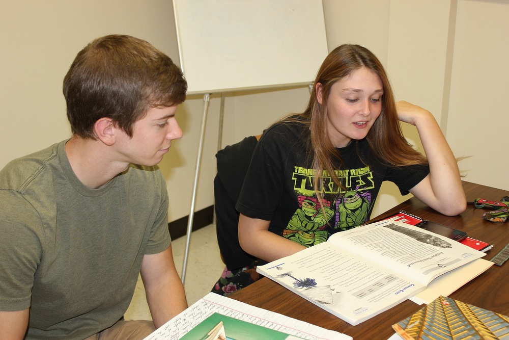 Peter Thompson, a volunteer tutor, works with a student one-on-one to help achieve her literacy goals.
