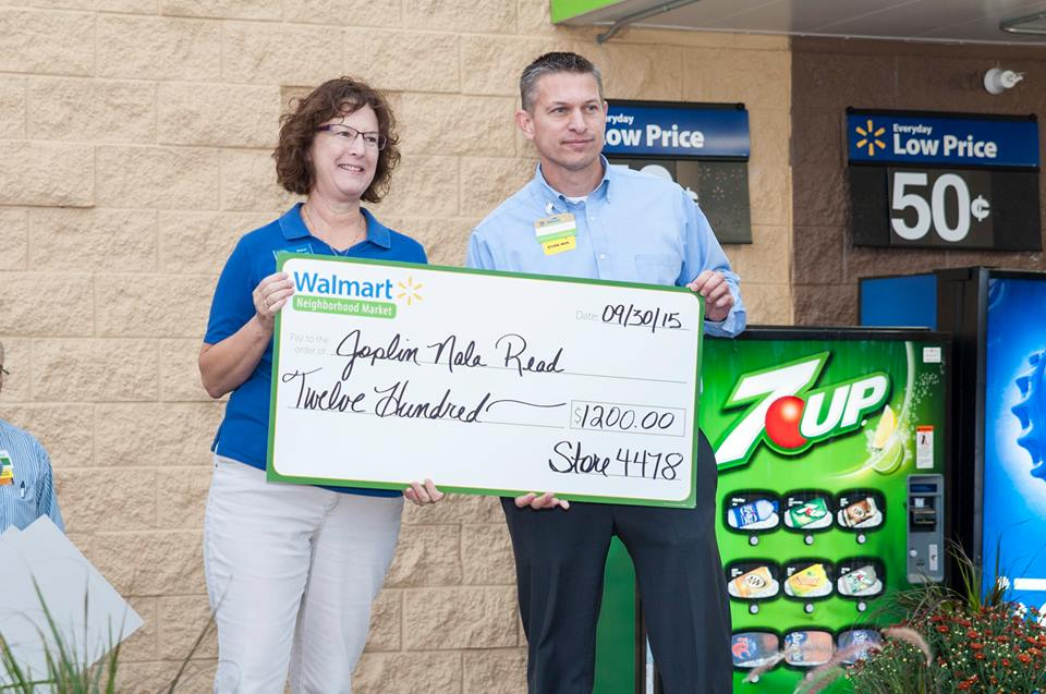 Joan Doner, Joplin NALA Read Program Coordinator, accepts a grant at the grand opening of Walmart Neighborhood Market Store #4478 in Joplin, MO.