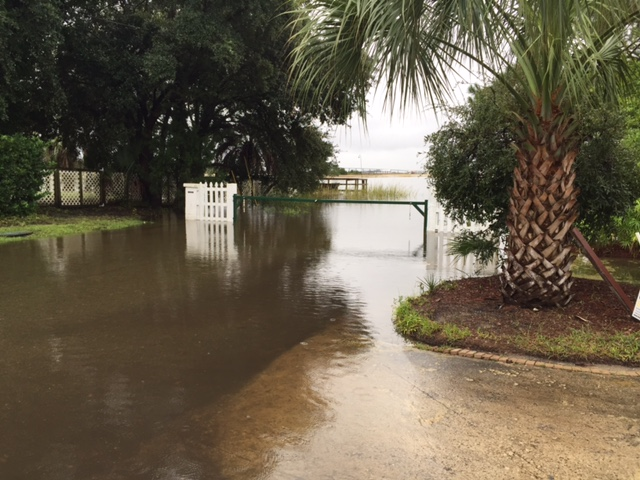 "The Capri Isle Boat Landing at Mrs. L's house on Sunday at high tide. Approximately 4"" of water in the streets. Fine time for boating!"