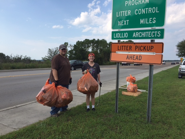 Liollio's Geoff Mohney & Allie Beck helping pick up during last week's Adopt-A-Highway clean up.