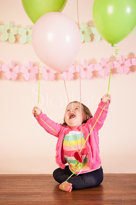 This is my favorite picture from the session. She just loved the balloons so much.