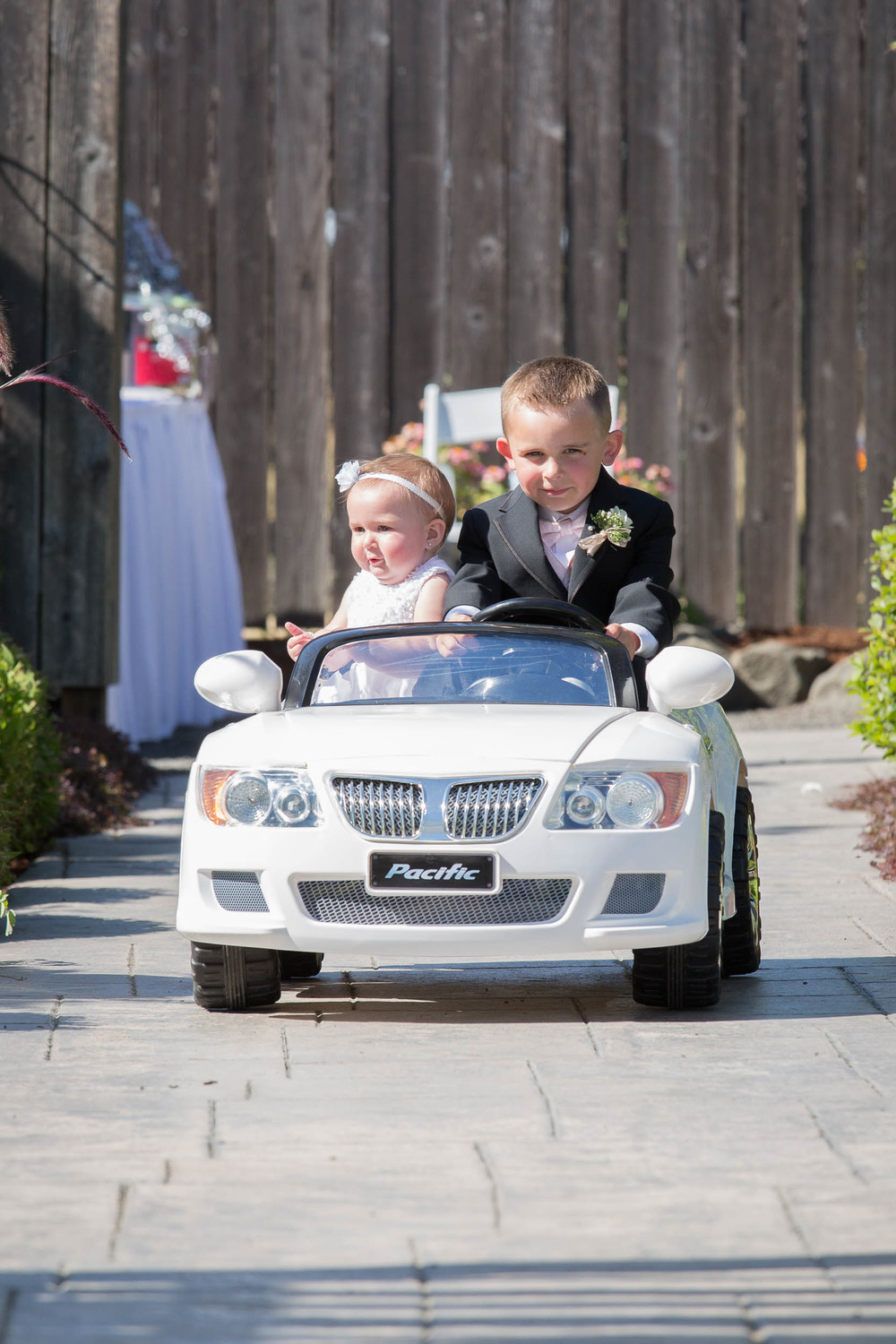 Ava and Wyatt are the cutest flower girl and ring bearer I have ever seen. The car that they drove down the isle was perfect. When they got to the front everyone started clapping. So sweet.