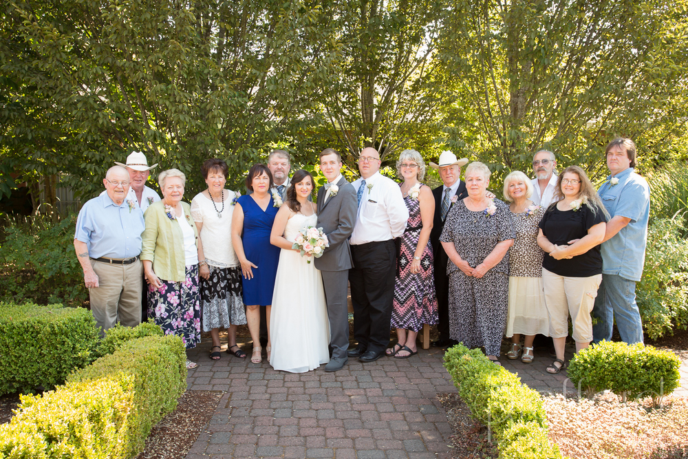 I love doing a big family portrait of the parents and grandparents with the Bride and Groom.