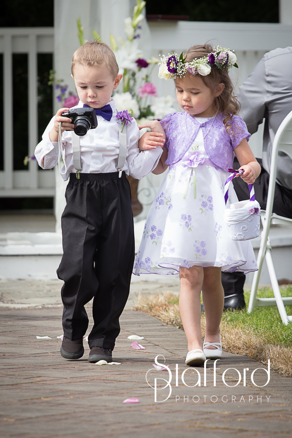 I just loved these two. Braden was so interested with the camera he wasn't wanting to walk down the aisle so adorable little Ava grabbed his hand it was so cute.