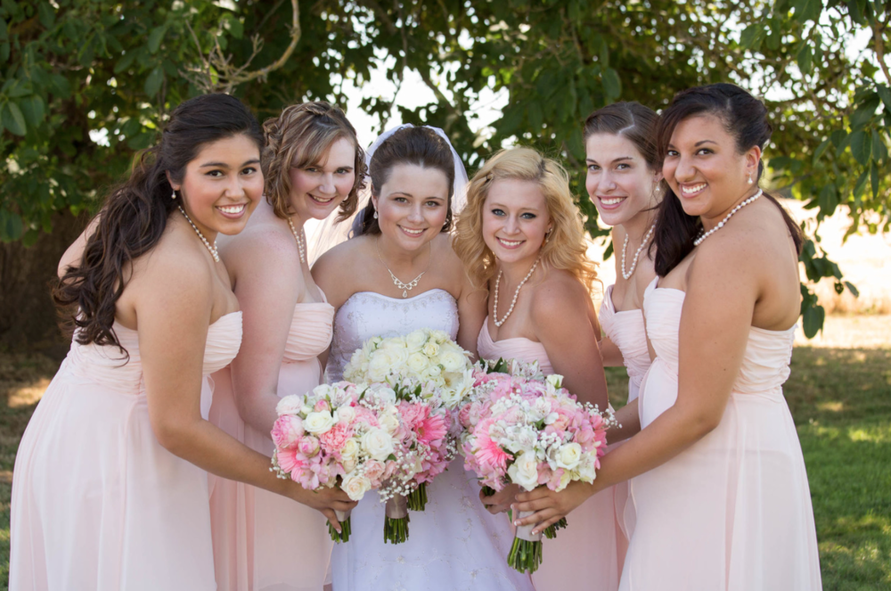 Beautiful image of the bride and bridesmaids. They are having fun and they look great.