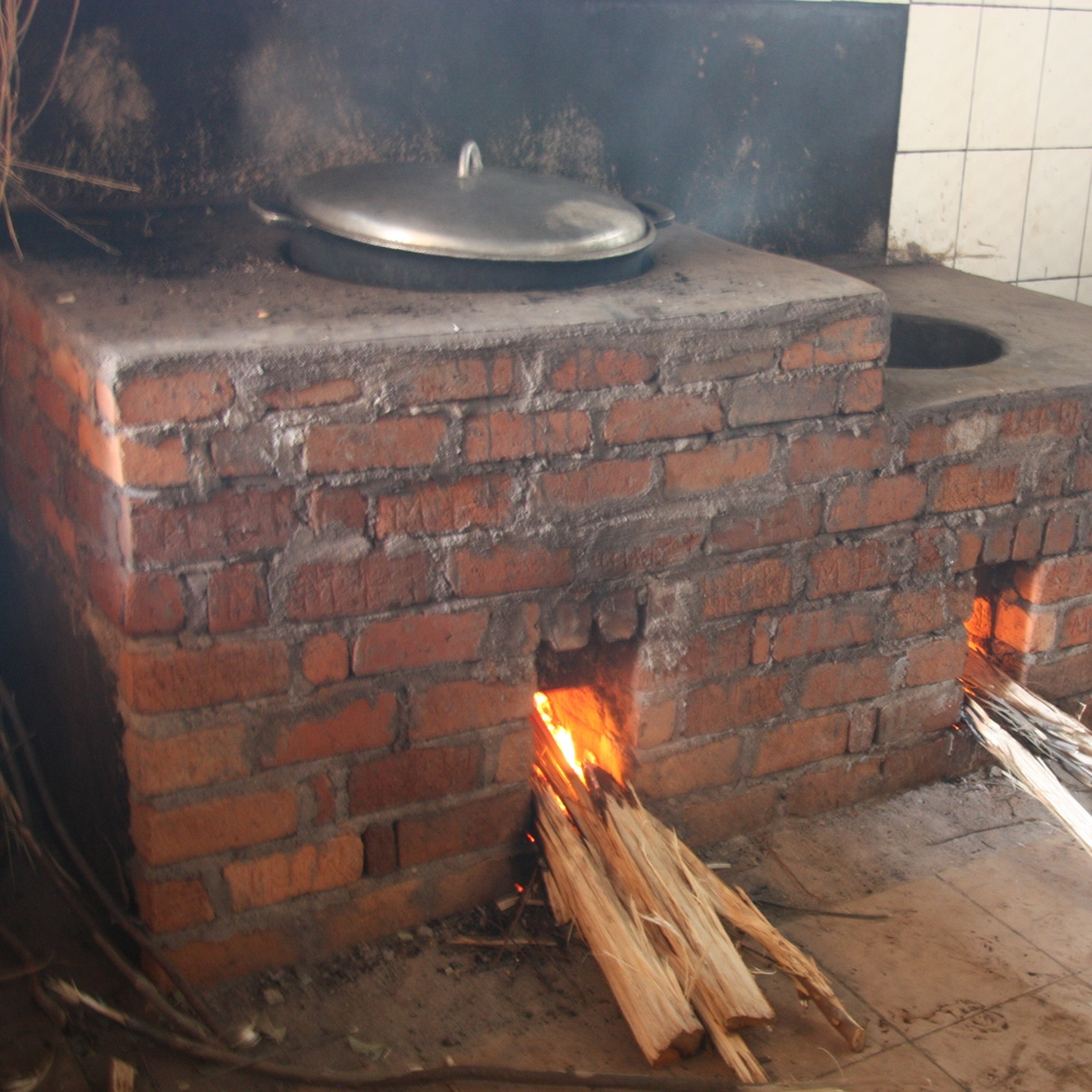 Rocket stoves drastically reduce carbon soot, smoke, and the amount of fuel burned while cooking.