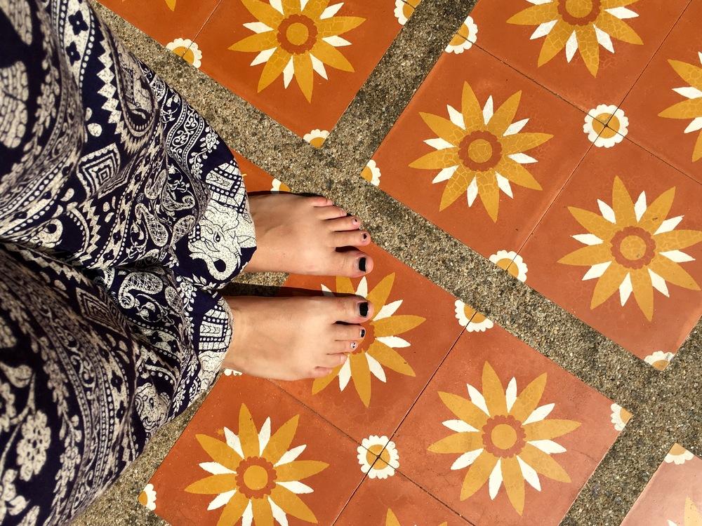 Navy pants + orange-tiled ground (+ Teva Tan)