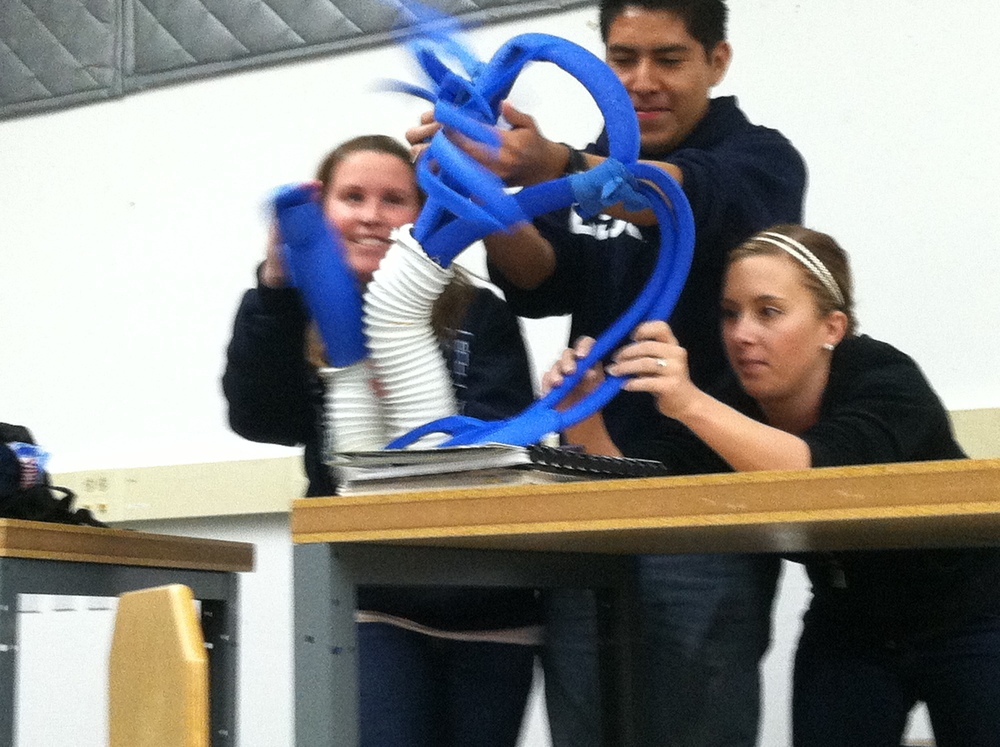 Children making hands for giant blue puppet