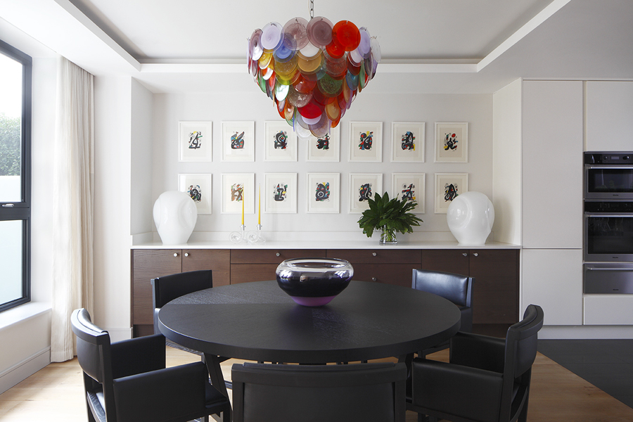 Dining area with colorful Murano glass chandelier and Murano lamps; Joan Miró artwork | Knightsbridge London | Savage Interior Design