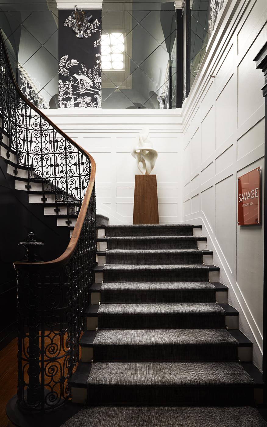 Staircase white paneled walls; Patterson Flynn & Martin runner; mirrored niche insets in harlequin pattern | Savage Interior Design