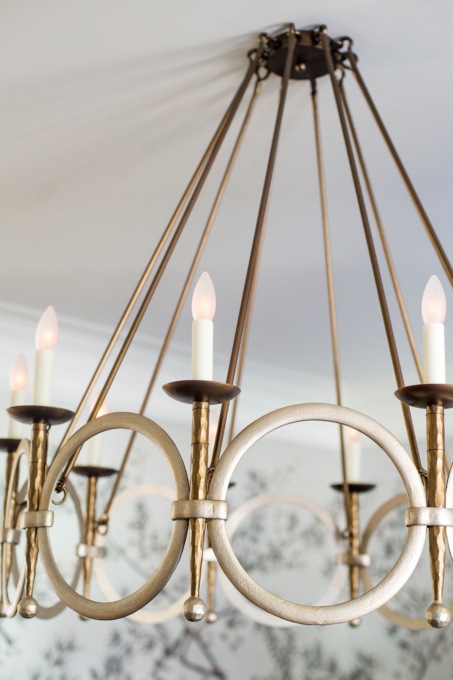 Gilt metal chandelier detail in gold and silver tones in luxurious Brentwood residence dining room | Savage Interior Design