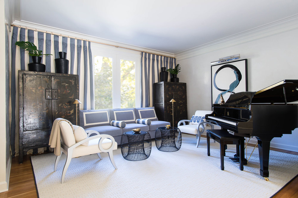 Blue and white seating area in music room flanked by chinoiserie cabinets and silver-leafed chairs | Savage Interior Design