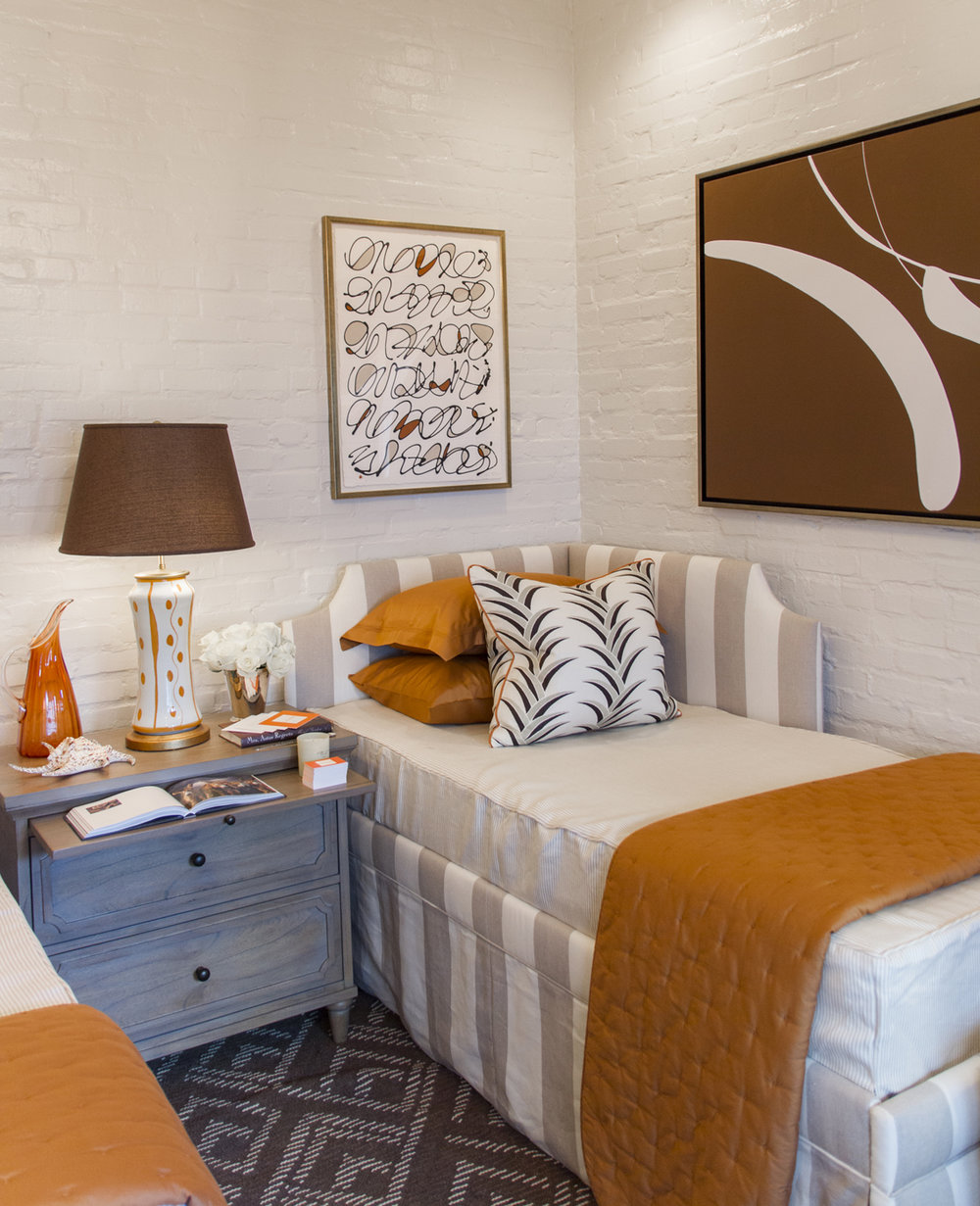 Bedroom in neutral colors with terracotta accents includes artwork by Kayce Hughes   Savage Interior Design