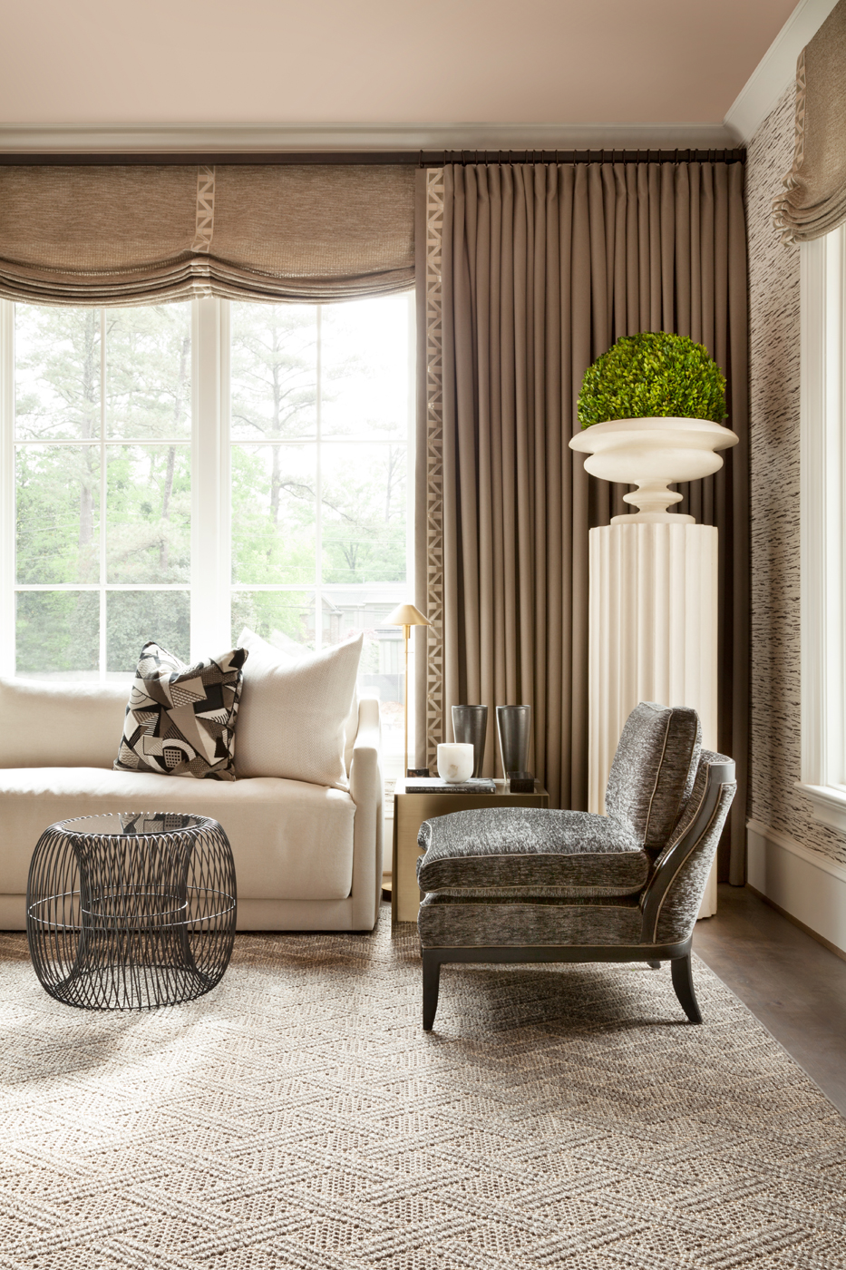 View of the calming Atlanta show house bedroom sitting area decorated with bold but elegant forms | Savage Interior Design