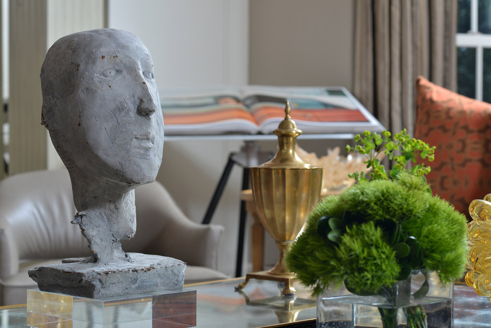 Modern sculpture of head displayed with decorative objects in Nashville residence | Savage Interior Design