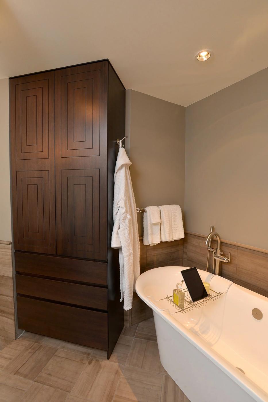 Custom master bathroom cabinetry with concentric rectangular box detail and Victoria + Albert bathtub | Savage Interior Design