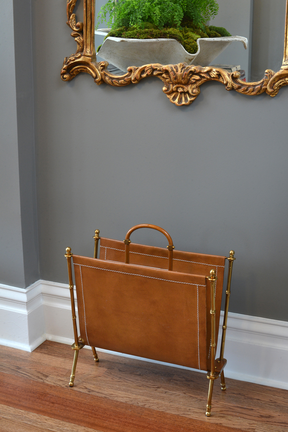 Detail of stylized metal faux bamboo and leather magazine holder in entry room | Savage Interior Design