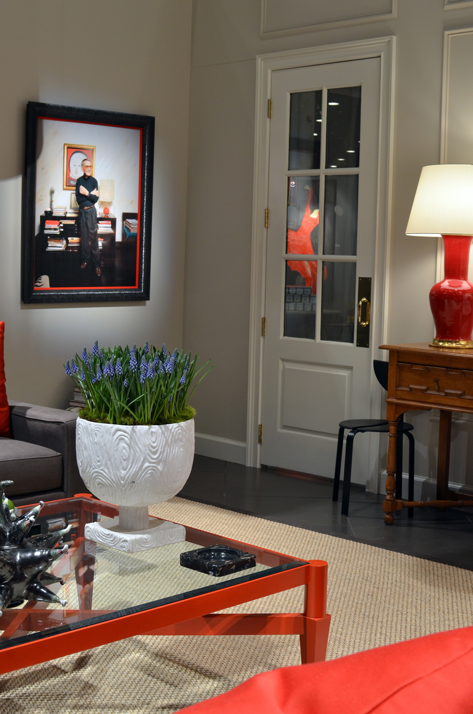 Photo of Albert Hadley on wall of living room installation   Savage Interior Design