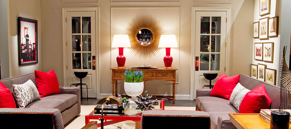 Neutral wall color in living room installation with gray and red accents   Savage Interior Design
