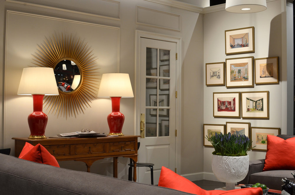 Red ceramic accent lamps on console table and grouping of framed interiors drawings by Hadley   Savage Interior Design