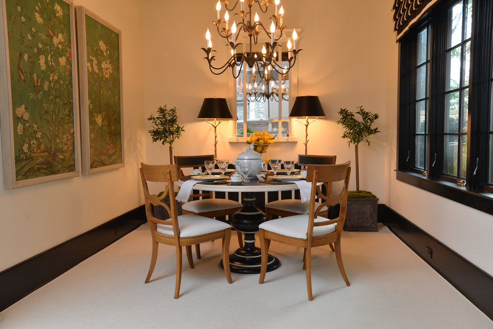 Show house dining room with table, chairs, server, lamps, mirror, chandelier, and chinoiserie panels | Savage Interior Design
