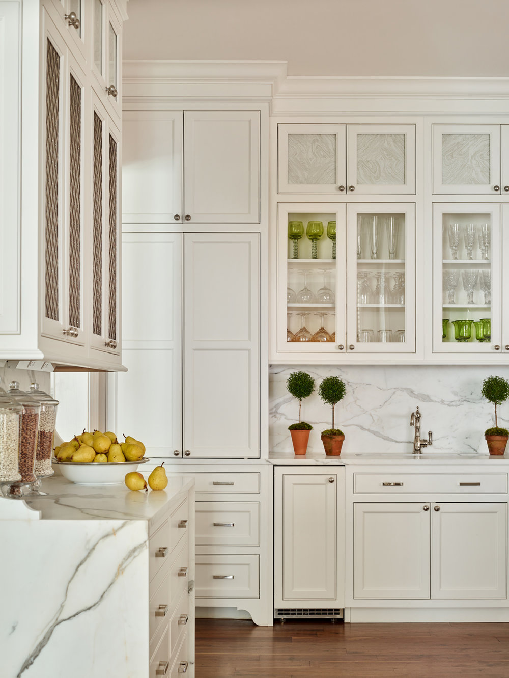 Custom white kitchen with waterfall Calacatta Borghini marble slabs; English-made mesh front upper cabinets | Savage Interior Design