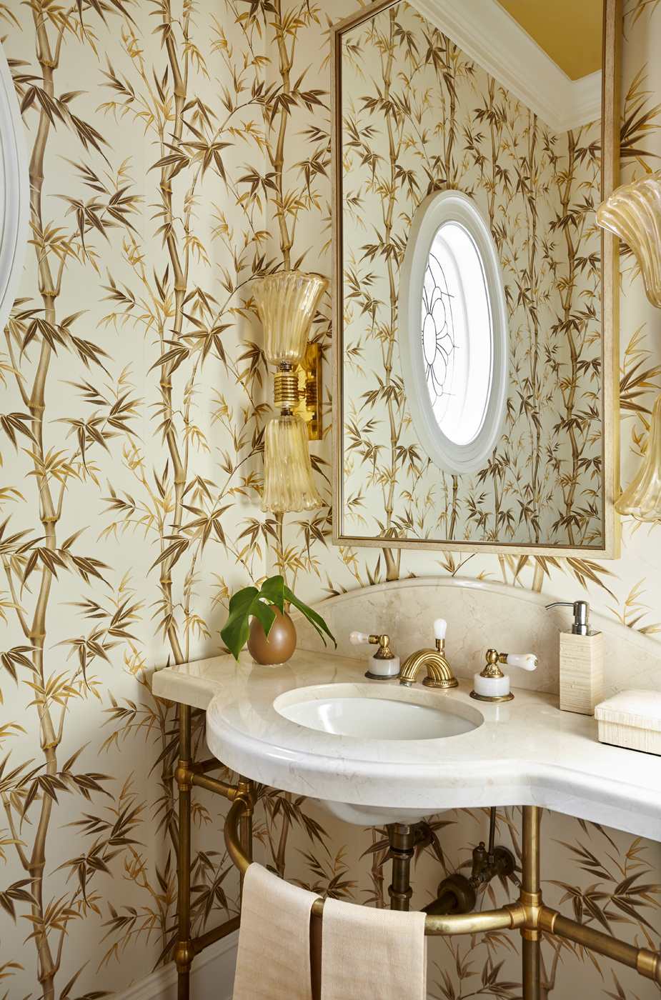 Powder room marble vanity top with brass legs set against a bamboo print wallcovering | Savage Interior Design
