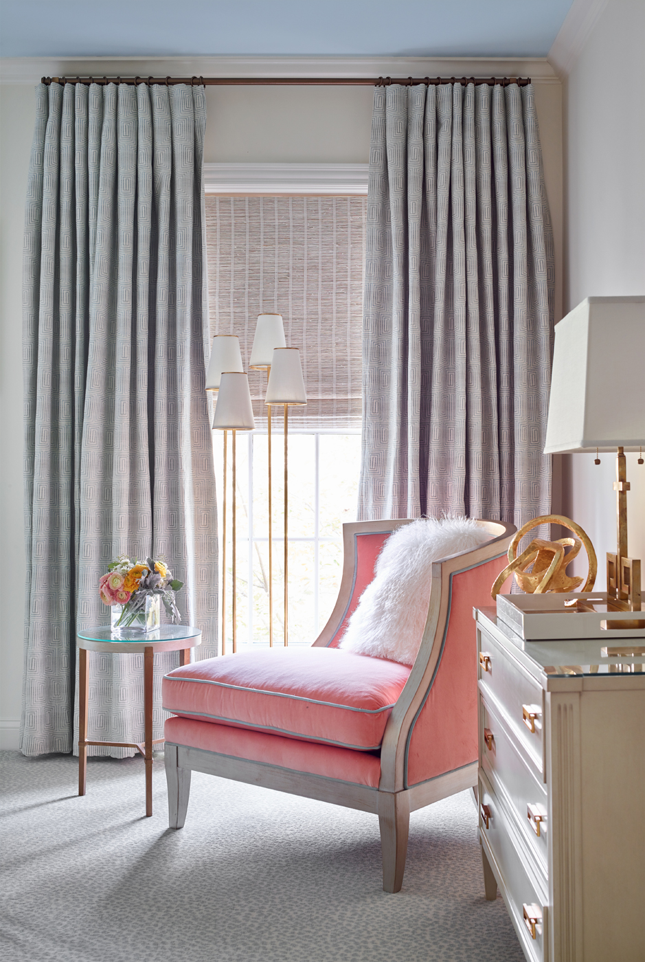 Bedroom seating with chest of drawers; upholstered slipper chair in coral fabric with blue trim | Savage Interior Design
