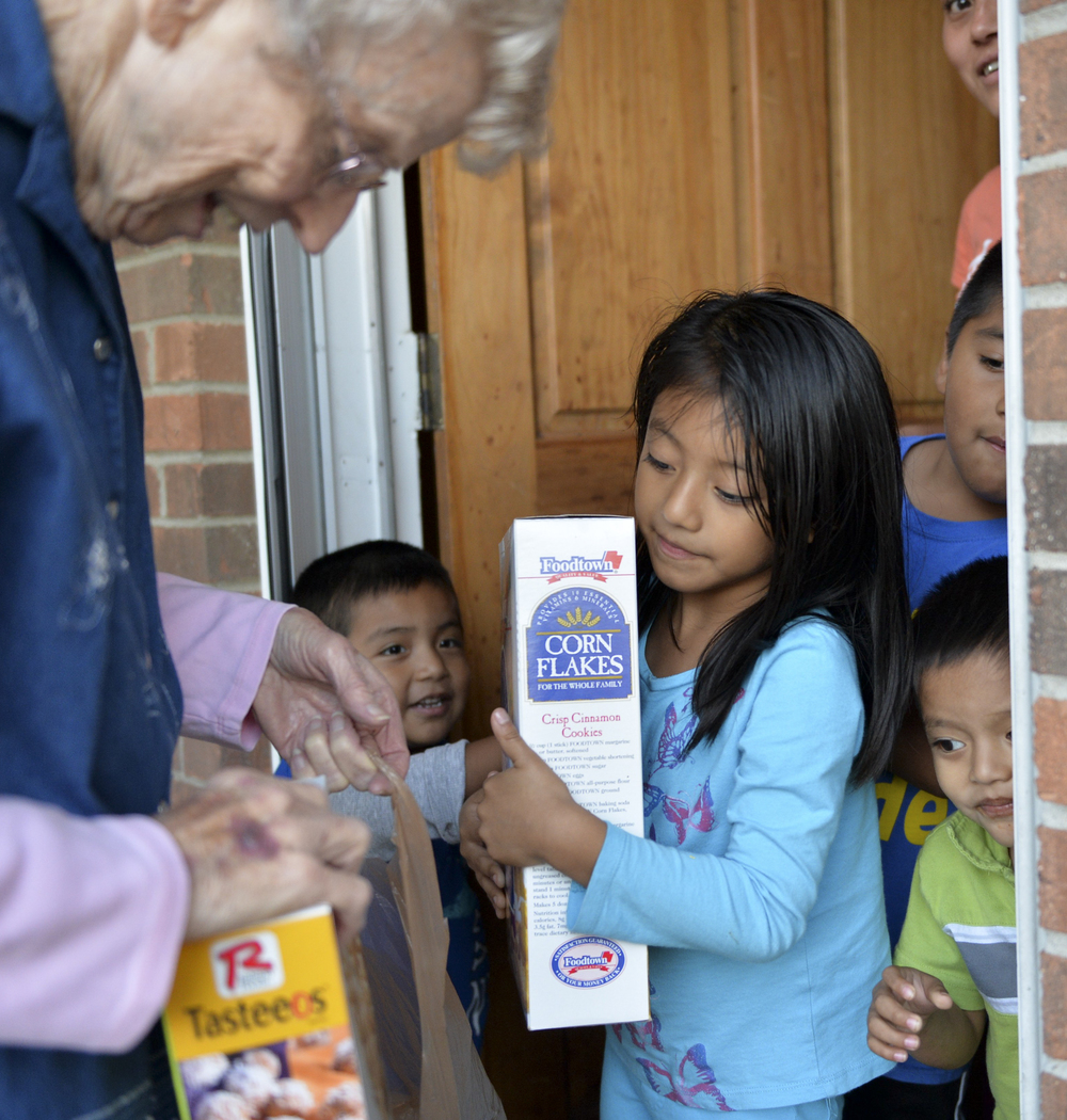"""Many of the Latino families in this community have a hard time getting around because either they don't have a car or they can't leave their children at home alone."" Sister Wilhelm helps families who can't get to the grocery store keep food in their pantries."