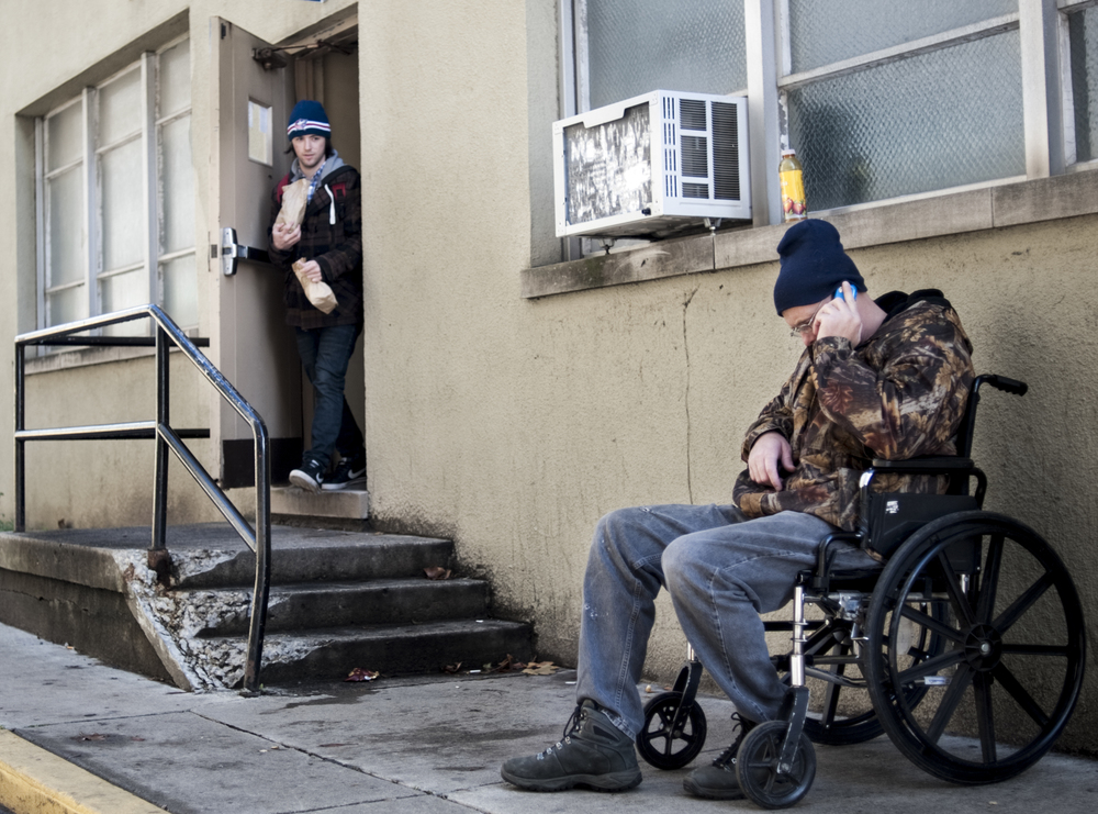 A man waits outside the Open Shelter for his friend to bring him a lunch. The Open Shelter offers sacked lunches and hot meals as well as many other services for the homeless in Columbus. Though the shelter cannot be used as overnight housing, the services it provides its customers are invaluable.