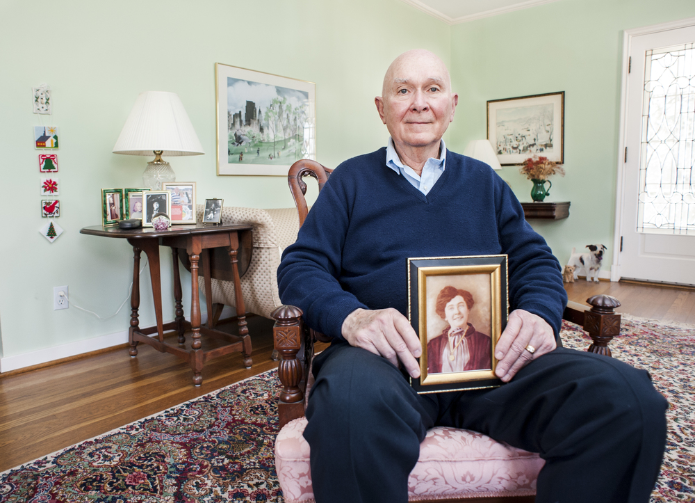 Earl Riley of Westerville, Ohio, poses in his home with a picture of his mother. While Earl served in Korea, his mother became terminally ill and her last wishes were to see her son before she passed away. The American Red Cross located Earl in Korea and was able to bring him back home to be with his mother in her last few days.