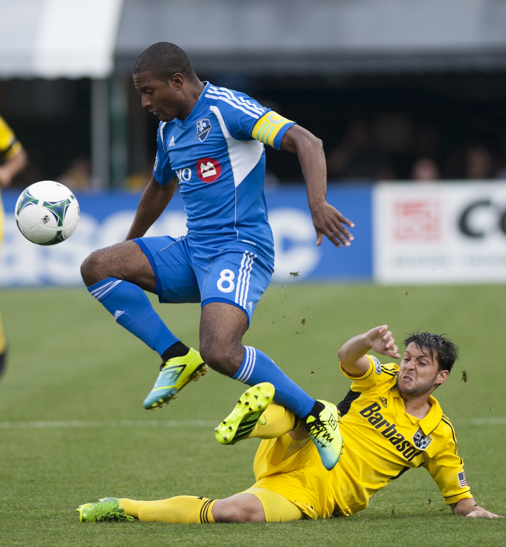 Montreal Impact's midfielder Patrice Bernier steals the ball from the Columbus Crew's Midfielder Matias Sanchez during the team's game at Crew Stadium on Saturday June 15th at Crew Stadium in Columbus, Ohio. The Crew would go on to score two goals in the first half of the game.